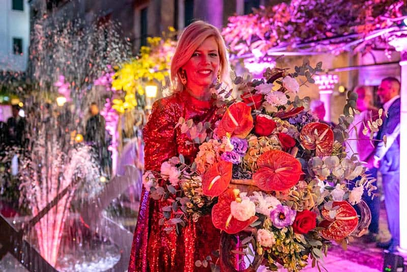 Opening Party with Elisabetta Dotto receiving flowers